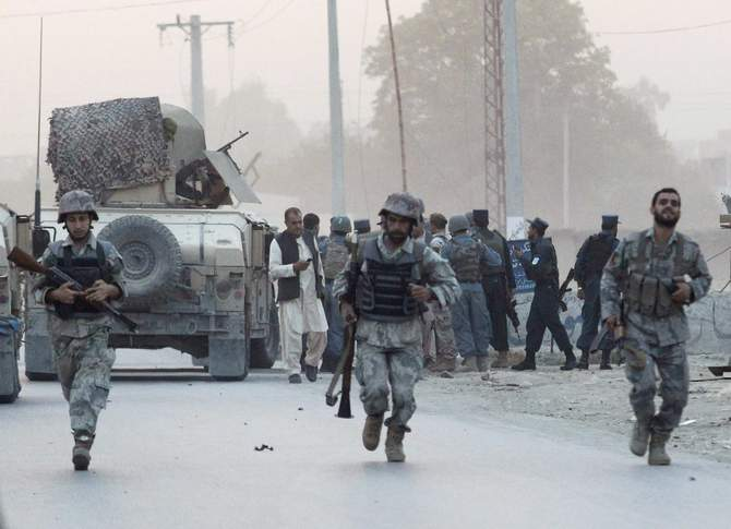Afghan security forces arrive at the site of an attack in the city of Jalalabad August 30, 2014. At least six people were killed and dozens wounded when a suicide car bomber and Taliban gunmen attacked an office of the Afghan intelligence agency in the eastern city of Jalalabad on Saturday, officials said. Photo: Reuters