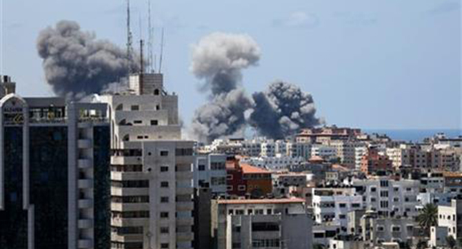 Smoke rises after an Israeli missile strike in Gaza City, Friday. Photo: AP