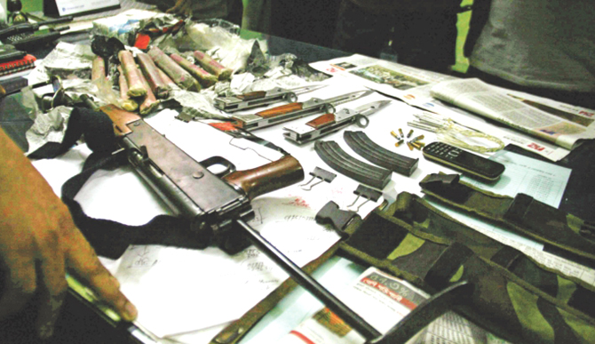 A semi-automatic weapon, bullets, and explosives among other arms railway police seized at Airport Railway Station yesterday. The photo was taken at Kamalapur Railway Station. Photo: Courtesy