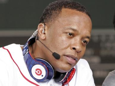 Recording artist Dr. Dre wears a pair of Beats headphones as he attends the MLB 2010 season opener between the New York Yankees and Boston Red Sox at Fenway Park in Boston, in this file photo taken April 4, 2010. Photo: Reuters