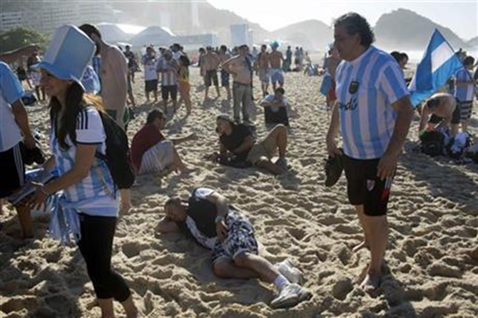 Argentina soccer fans gather after spending the night on Copacabana Beach in Rio de Janeiro, Brazil, Sunday, July 13. Photo: AP