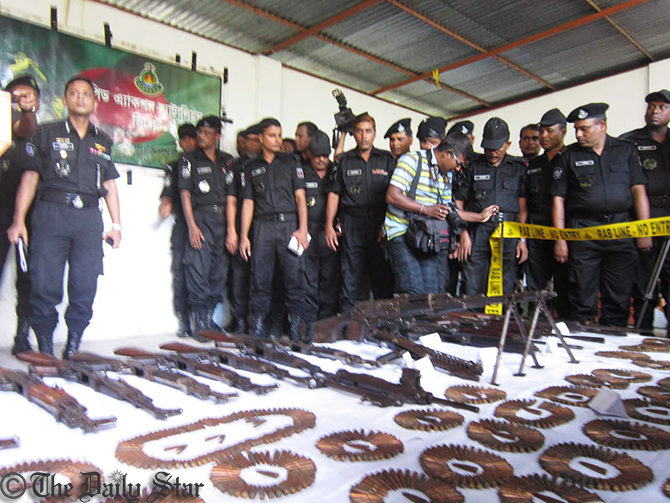 Rab personnel display arms and ammo, recovered from Satchhari forest in Habiganj, during a press briefing at the headquarters of Crime Prevention Company (CPC-2) in Srimangal upazila of Moulvibazar Tuesday. Photo: Star