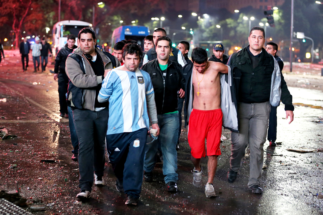 Police detain Argentine soccer fans after violence erupted near the Obelisco de Buenos Aires after their team lost to Germany 1-0 during the World Cup final on July 13, 2014 in Buenos Aires, Argentina. Photo: Getty Images