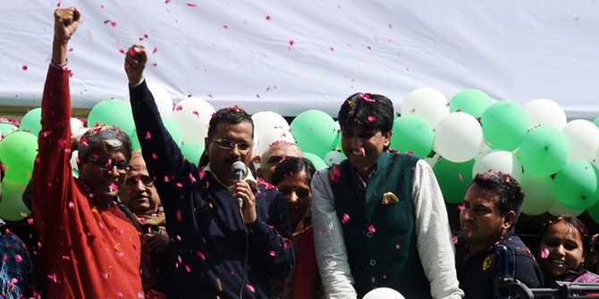 Indian Aam Aadmi Party (AAP) leader Arvind Kejriwal gestures as he speaks to supporters following his victory in the state assembly elections outside the party's headquarters in New Delhi on February 10, 2015. Photo: AFP