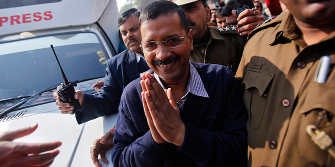1.Aam Aadmi (Common Man) Party (AAP) chief and its chief ministerial candidate for Delhi, Arvind Kejriwal gestures to his supporters after casting his vote outside a polling station during the state assembly election in New Delhi February 7, 2015. Photo: Reuters