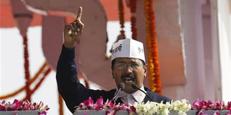 This AP file photo taken on December 28, 2013 shows Aam Aadmi Party, or Common Man's Party, leader Arvind Kejriwal speaks to the crowd after being sworn-in as chief minister of Delhi in New Delhi, India.