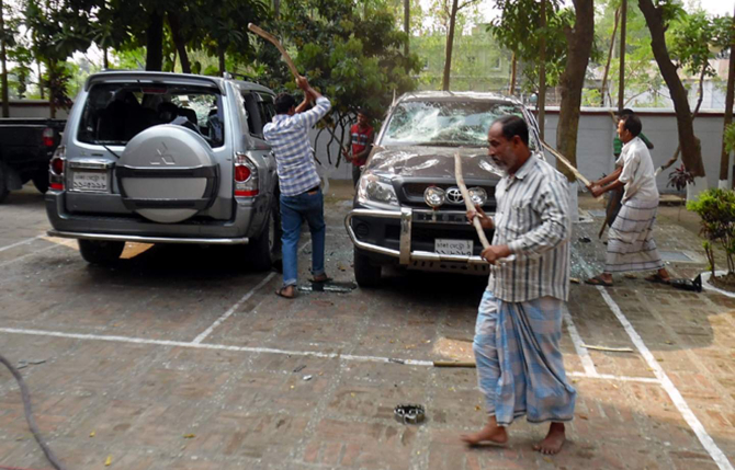 People of Phulbari area in Dinajpur vandalise two vehicles of Asia Energy Corporation (Bangladesh) in front of the company's local office in Phulbari municipality area on Wednesday, protesting the visit of Gary Lye, chief executive officer (CEO) of Asia Energy. Photo: Star