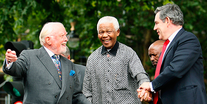 Britain's then Prime Minister Gordon Brown (R) and director Richard Attenborough assist South Africa's former President Nelson Mandela (C) to the podium, during the unveiling ceremony of a statue in Mandela's honour in London's Parliament Square, in this file picture taken August 29, 2007. Photo: Reuters