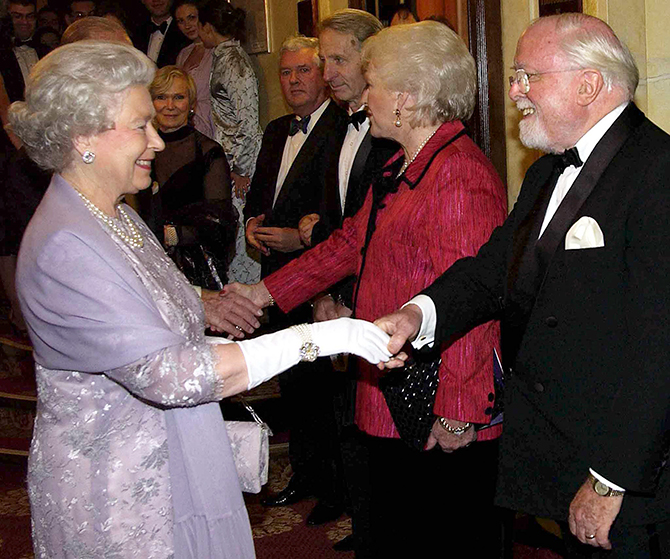 Britain's Queen Elizabeth meets Sir Richard Attenborough and his wife at a gala performance of