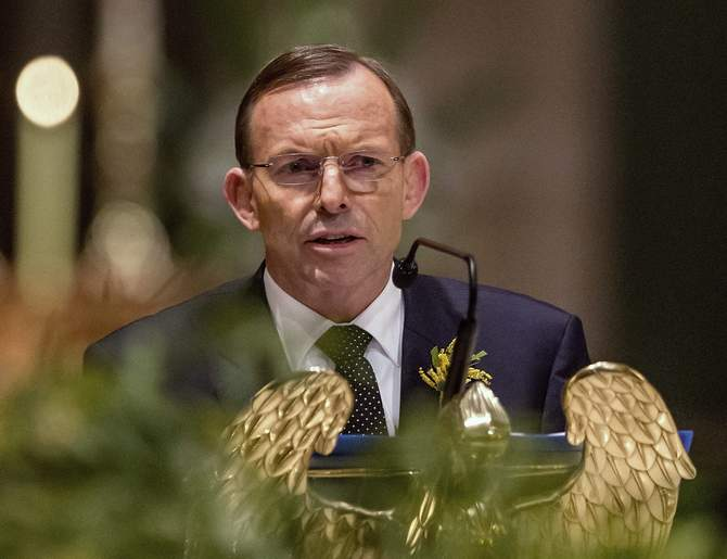 Australian Prime Minister Tony Abbott delivers remarks at a national memorial service for the victims of Malaysia Airlines flight MH17 at St Patrick's Cathedral in Melbourne August 7, 2014. Photo: Reuters