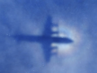 A shadow of a Royal New Zealand Air Force P-3 Orion aircraft is seen on low cloud cover while it searches for missing Malaysia Airlines Flight MH370. Photo: AP