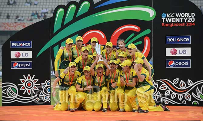 Australia Women celebrate with the World T20 trophy at Mirpur Sunday after beating England Woman by 6 wickets. Photo: Firoz Ahmed