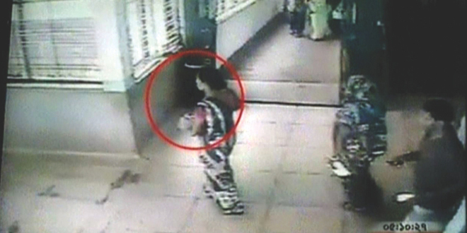 CCTV footage shows the suspect taking one of the twins to a doctor at DMCH at 10:51am on Wednesday apparently to gain the mother's trust. The woman stole one of the twins on August 21. Photo: TV grab (Somoy TV)