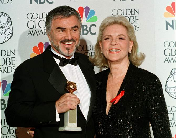 "3.	Actors Burt Reynolds and Lauren Bacall pose for photographers as Reynolds holds his Golden Globe that he won for best supporting actor in a motion picture for the film ""Boogie Nights"", at the 55th annual Golden Globe Awards in Beverly Hills, in this file picture taken January 18, 1999. Photo: Reuters"