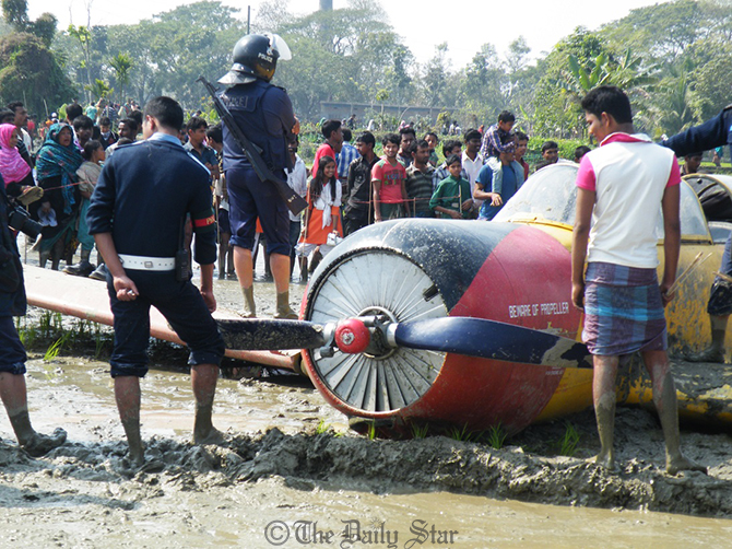 The plane hit the paddy field in Mahidia area of Jessore Sadar upazila just an hour after it took off from Jessore Airport on Thursday. Photo: Star