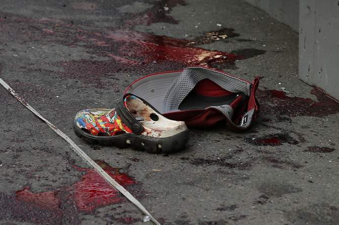 A shoe and a cap are seen near blood stains following a bomb blast in Bangkok on February 23. Photot: Reuters
