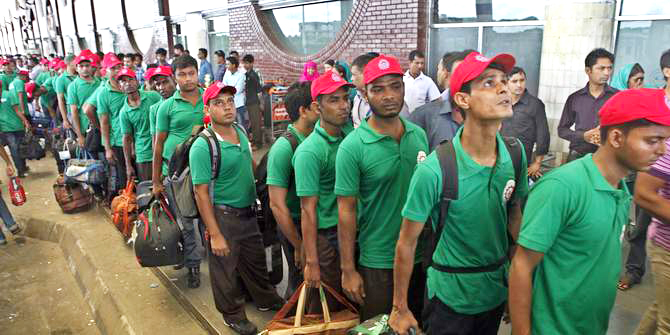 In this Star file photo, Bangladeshi workers stand in line to enter Shahjalal International Airport in Dhaka, before flying to a foreign country for jobs.