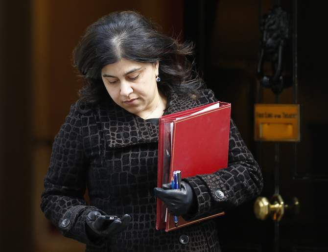 This file photograph shows British Senior Minister of State at the Foreign and Commonwealth Office, Baroness Sayeeda Warsi, leaving 10 Downing Street after a cabinet meeting in central London March 4, 2014. Photo: Reuters