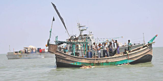 This Star photo taken on April 2, 2013 shows members of Bangladesh Navy are searching for bodies of missing fishermen in the Bay of Bengal at Kutubdia of Cox's Bazar.