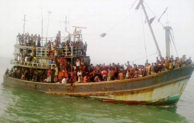 This Banglar Chokh photo taken on June 11 shows 120-foot trawler with 330 people on board set off for Malaysia from Moheshkhali coast in Cox's Bazar.