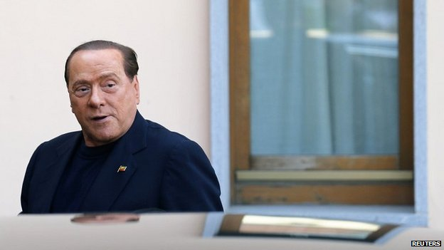 Former Italian Prime Minister Silvio Berlusconi looks on as he arrives at the Sacred Family Foundation, where he will serve part of his one-year tax fraud sentence by doing community service with the elderly, in Cesano Boscone, a small town on the outskirts of Milan May 9, 2014. Photo: Reuters