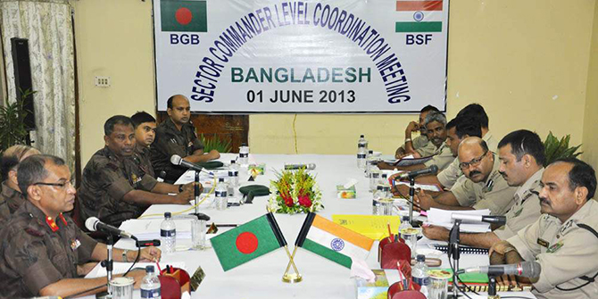 This Star photo taken on June 1, 2013 shows Border Guard Bangladesh and Border Security Force members of India taking part in a sector commander level coordination meeting at National Guarden Ramsagar Rest House in Dinajpur.