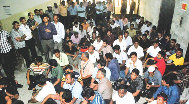 In the June 30 photo, employees of Biman Bangladesh Airlines lay siege to office of acting managing director in the capital demanding regularisation of job.