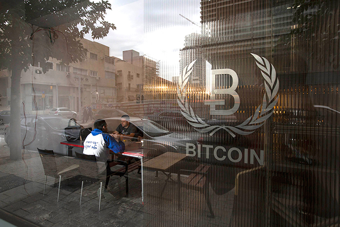"This Reuters photo taken on February 2 shows people sitting inside the Bitcoin Embassy in Tel Aviv. In the first confirmation of a criminal investigation at Mt. Gox, the failed Tokyo-based bitcoin exchange said on march 26 it was working with the police ""with regard to the disappearance"" of bitcoins worth some $490 million at current prices. Mt. Gox filed for bankruptcy protection in Tokyo on February 28, saying 750,000 bitcoins belonging to its customers and 100,000 of its own bitcoins were stolen by hackers who exploited a security flaw in its software. It also said $28 million were ""missing"" from its Japanese bank accounts."