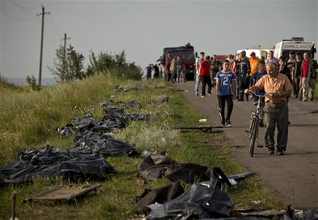 Bodies of victims are placed in plastic sacks by the side of the road at the crash site of Malaysia Airlines Flight 17 near the village of Hrabove, eastern Ukraine, Saturday, July 19. Photo: AP