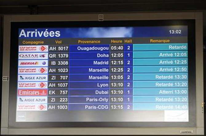 An arrival information screen shows the delayed Air Algerie flight 5017 (top) at the Houari Boumediene airport near Algiers, Algeria, Thursday, July 24, 2014. Photo: AP
