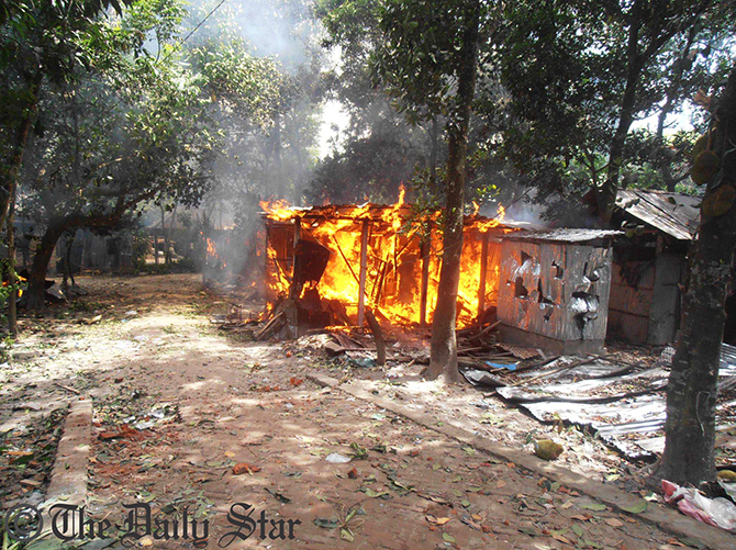 A house is set on fire during a clash between two village people in Kurigram Sadar Upazila Thursday morning. Around 50 houses and several shops of Shandarpara were burnt in the clash. Photo: Star