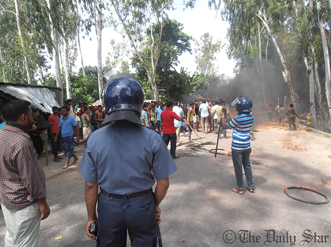 Law enforcers take position during a deadly clash between people of two villages in Kurigram Sadar upazila on Thursday. Photo: Star
