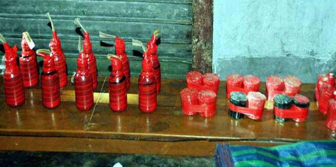 In this December 19, 2013 file photo- 25 crude bombs are seen which Rab officials found in abandoned condition in Chatmohar upazila of Pabna.