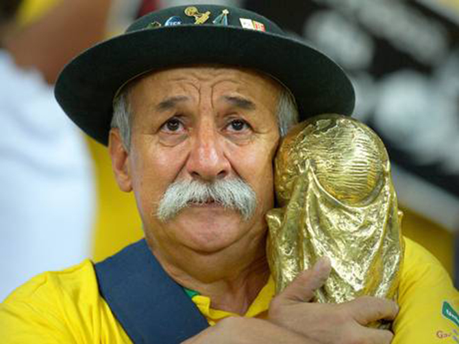 A Brazilian fan shows his dejection after the semi final defeat. The photo is taken from independent.co.uk