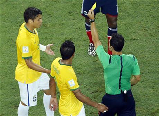 Brazil's Thiago Silva gets a yellow card during the World Cup quarterfinal soccer match between Brazil and Colombia at the Arena Castelao in Fortaleza, Brazil on July 4. Photo: AP