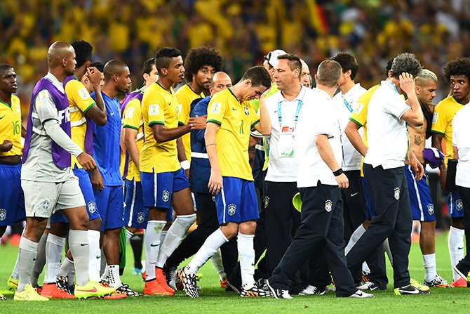 Oscar of Brazil (center) reacts with teammates after being defeated 7-1 by Germany during the 2014 FIFA World Cup Brazil Semi Final match between Brazil and Germany at Estadio Mineirao on July 8, 2014 in Belo Horizonte, Brazil. Photo: Getty Images