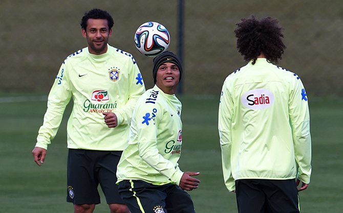 (L-R) Brazil's forward Fred, Brazil's defender and captain Thiago Silva and Brazil's defender David Luiz take part in a training session at the Granja Comary training complex in Teresopolis on July 6, 2014 during the 2014 FIFA World Cup in Brazil. Photo: AFP/ Getty Images