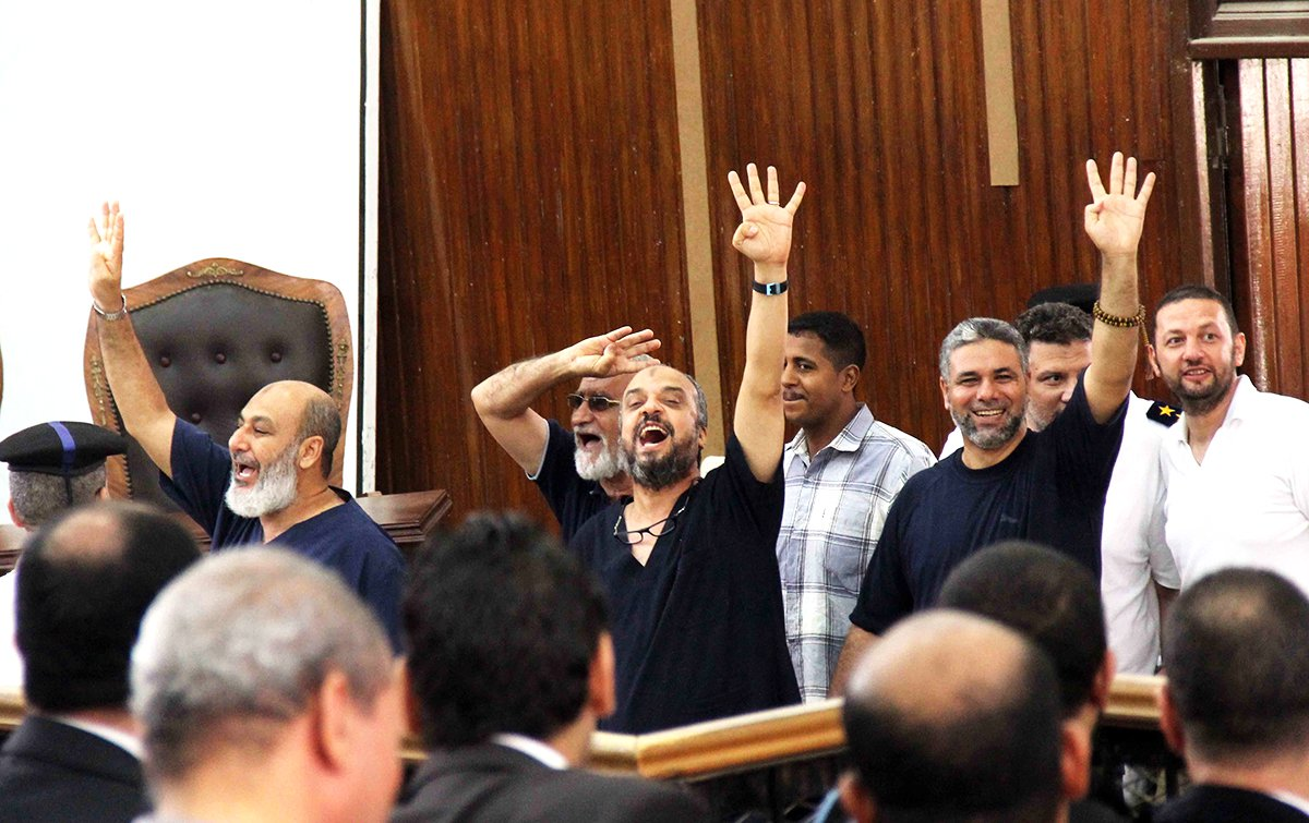 Mohammed Badie (2nd L), Supreme Guide of the Muslim Brotherhood, Mohamed Beltagy (3rd L), general secretary of the Freedom and Justice Party, and Safvet Hicazi (L), one of the anti-coup leaders of the National Alliance, were sentenced to life imprisonment. Photo: Getty Images