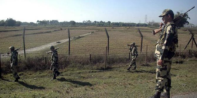 This AP file photo shows BSF members patrol at the India-Bangladesh border in Fulbari, about 25 kilometre from Siliguri.