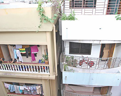 This Star file photo shows a six-storey building, right, tilted towards the adjoining five-storey building, left, in Chittagong city last year.