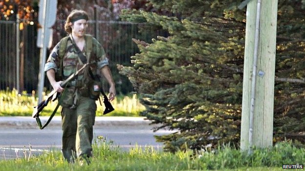 A heavily armed man identified as Justin Bourque was photographed in Moncton at the time of the shootings