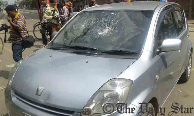 BNP men vandalise a private car when clash with police after BNP Chairperson reached at a court premises in Dhaka around 1:05pm Wednesday in connection with Zia Orphanage and Zia Charitable Trust graft cases. Photo: Prabir Barua