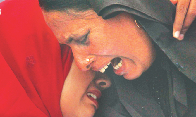 Relatives of victims break down in tears during a civil demonstration against extrajudicial killings and disappearances in front of the Jatiya Sangsad Bhaban on May 5. Star file photo