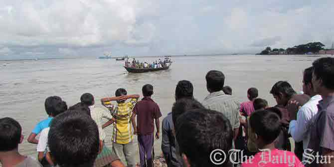 Locals rush on the bank of Meghna after a clinker-laden cargo vessel capsizes in the river Tuesday morning. Photo: Star