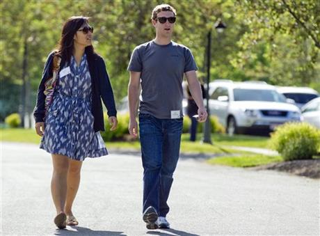 In this July 9, 2011 file photo, Mark Zuckerberg, president and CEO of Facebook, walks with Priscilla Chan during the 2011 Allen and Co. Sun Valley Conference, in Sun Valley, Idaho. Zuckerberg and his wife Chan were the most generous American philanthropists in 2013, with a donation of 18 million Facebook shares, valued at more than $970 million, given to a Silicon Valley nonprofit in December. Photo: AP