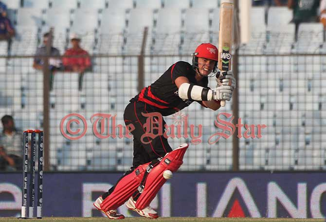 Hong Kong batsman Chapman's valiant effort went to vein as Afghanistan beat his team by 7 wickets in World T20 at Chittagong Stadium on Tuesday. Photo: Firoz Ahmed