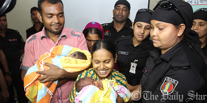 Runa Begum, wife of Kawsar Hossain Babu of Mohammadpur, gave birth to twin baby boys around 5:00am on August 20. Photo: Palash Khan