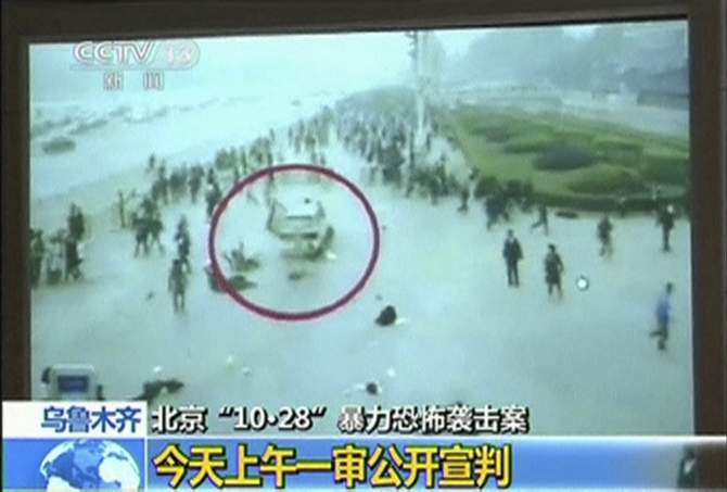 The footage of an October attack on the edge of Beijing's Tiananmen Square is seen in court during the trial of three people involved in this still image taken from video in Urumqi city, in this June 16, 2014 file photo. Photo: Reuters