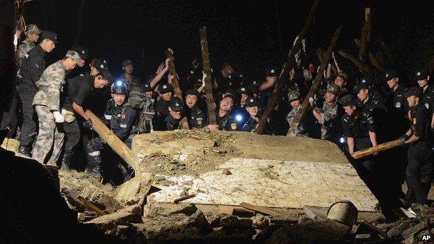 The landslide hit the village in south-west Guizhou province on Wednesday night