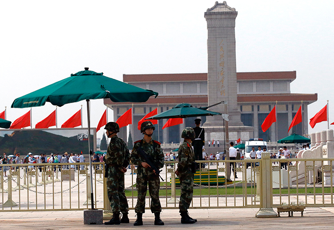 Paramilitary soldiers stand guard in front of Tiananmen Square in Beijing on Wednesday. China to mark 25 years since authorities opened fire on student-led protests in Tiananmen Square, and as the anniversary approached, authorities have deployed hundreds of police, many armed with rifles, to patrol the area. Photo: Reuters